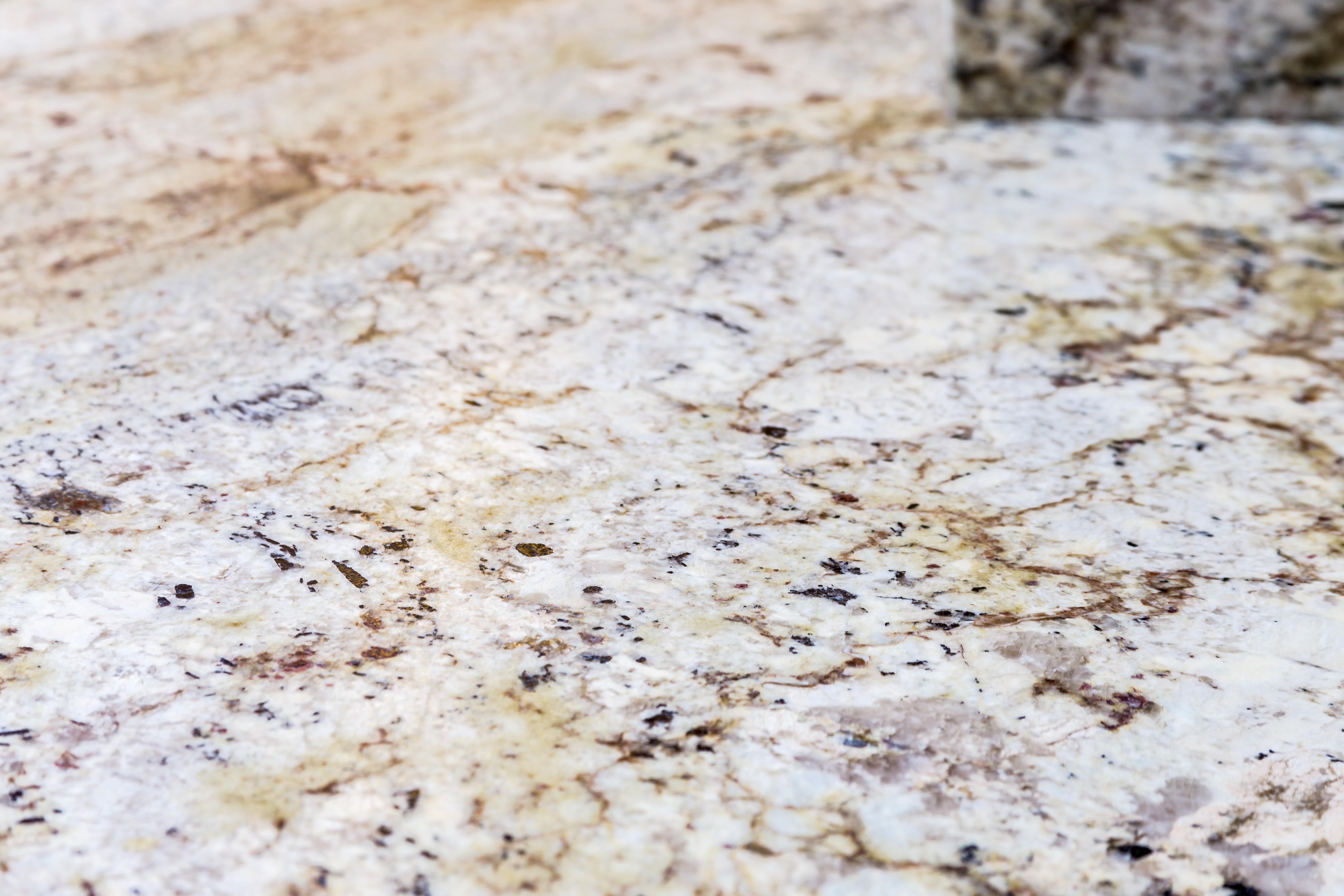 Northern Granite Typhoon Bourdeaux Leathered Granite Kitchen
